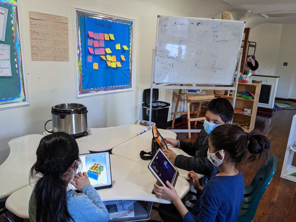 Kids coding on their iPads